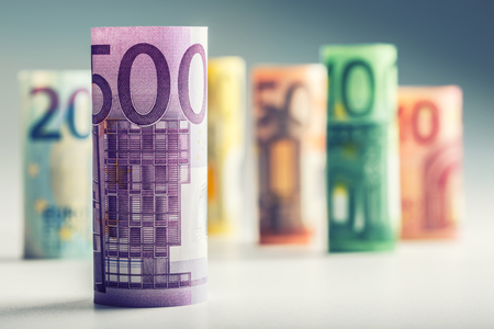european currency: Several hundred euro banknotes stacked by value. Euro money concept. Rolls Euro  banknotes. Euro currency. Announced cancellation of five hundred euro banknotes. Banknotes stacked on each other in different positions. Toned photo.