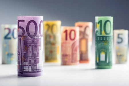 Several hundred euro banknotes stacked by value. Euro money concept. Rolls Euro banknotes. Euro currency. Announced cancellation of five hundred euro banknotes. Banknotes stacked on each other in different positions. Toned photo. Reklamní fotografie
