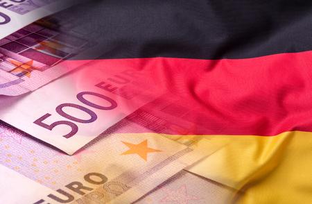 Flagi Niemiec i Unii Europejskiej. Niemcy Flaga i Flaga UE. Świat flagi koncepcja pieniędzy. Zdjęcie Seryjne