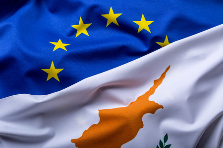 economy crisis: Flags of the Cyprus and the European Union. Cyprus Flag and EU Flag. World flag money concept. Stock Photo