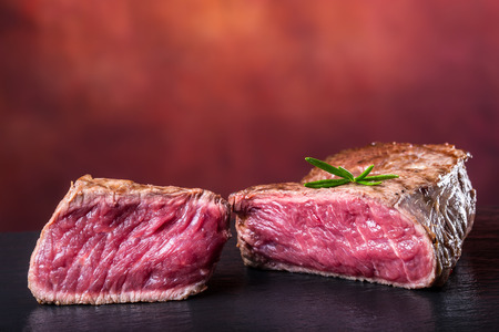 teflon: Grill beef steak. Portions thick beef juicy sirloin steaks on grill teflon pan or granite board. Stock Photo