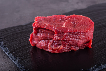 Steak. Raw beef steak. Fresh raw Sirloin beef steak sliced o Herb - Rosemary decoration. Stock Photo