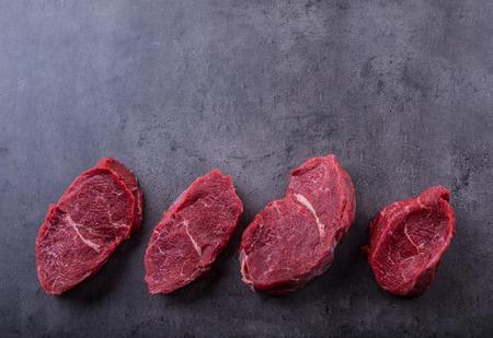 Steak. Raw beef steak. Fresh raw Sirloin beef steak sliced o Herb - Rosemary decoration.