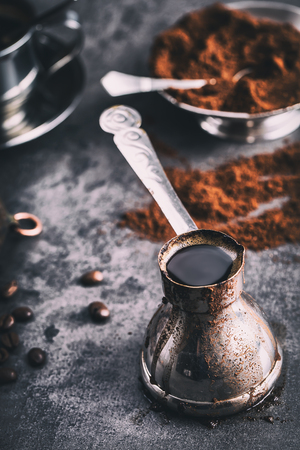 cezve: Coffee. Turkish coffee. Armenian Turkish coffee. Cezve and cup of coffee. Traditional serving coffee. Stock Photo
