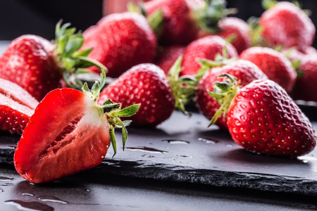 loosely: Strawberry. Fresh strawberry. Red strewberry. Strawberry Juice. Loosely laid strawberries in different positions. Stock Photo
