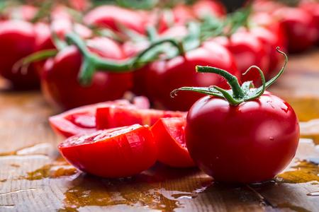 clean cut: Fresh cherry tomatoes washed clean water. Cut fresh tomatoes.