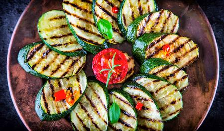 greek cuisine: Grilled Zucchini Tomato with chili pepper.  Italian mediterranean or greek cuisine. Vegan vegetarian  food. Stock Photo