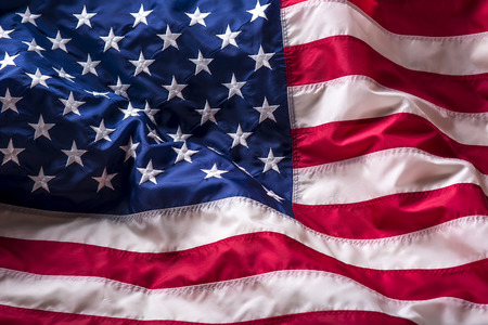 blowing of the wind: USA flag. American flag. American flag blowing wind. Fourth - 4th of July. Stock Photo