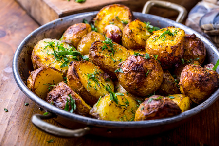 dill and parsley: Potato. Roasted potatoes. American potatoes with smoked bacon garlic salt pepper cumin dill parsley - herb decoration.