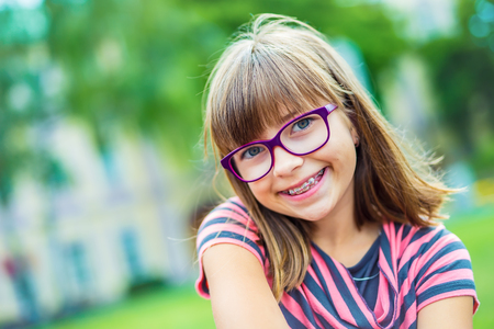 Girl. Teen. Pre teen. Girl with glasses. Girl with teeth braces. Young cute caucasian blond girl wearing teeth braces and glasses. Stock fotó