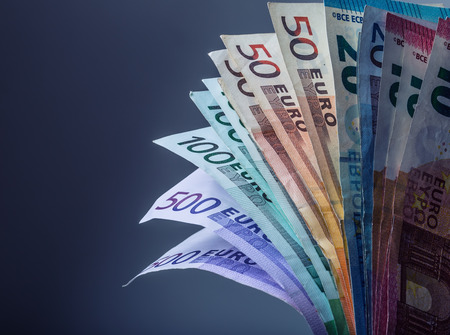Several hundred euro banknotes stacked by value. Euro money concept. Euro banknotes. Euro currency. Banknotes stacked on each other in different positions. Toned photo.
