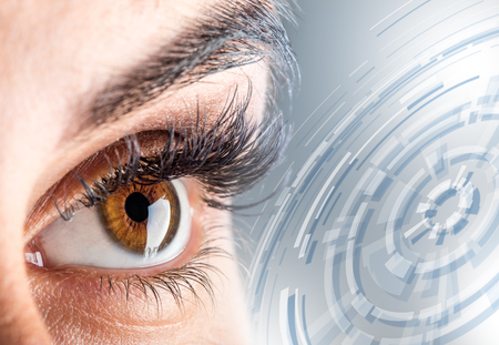 Close-up of womans eye. macro beautiful female eye.New futuristic and technology  concept. Stock Photo