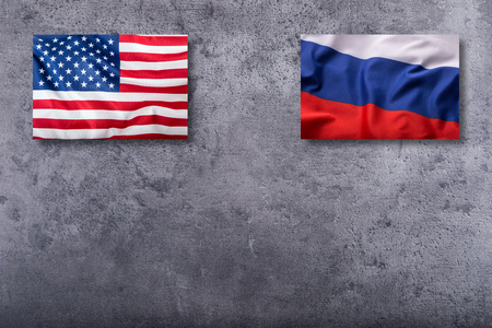 usa flags: Flags of the USA and russia on concrete background. Stock Photo