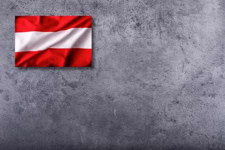 Austria flag on concrete background.