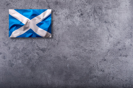 scottish flag: Scotland flag. Scottish flag on concrete background.