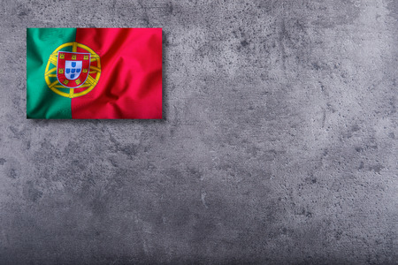 portugal flag: Portugal flag on concrete background. Stock Photo