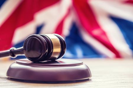 jurisdiction: Judges wooden gavel with UK flag in the background. Symbol for jurisdiction.