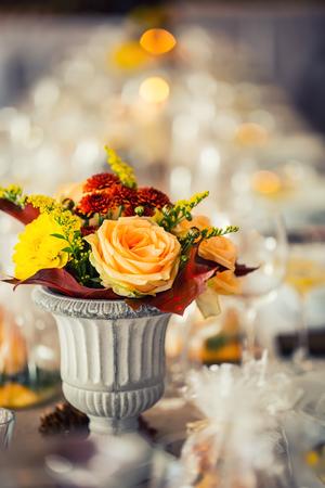 Wedding table. Flowers arrangement bouquets as decoration for wedding.