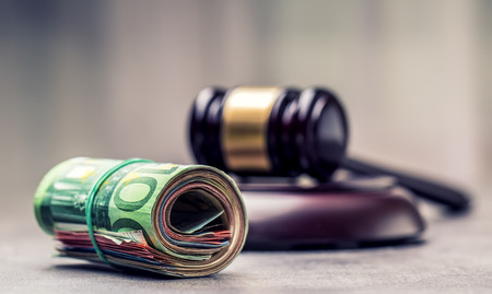 auction win: Judges hammer gavel. Justice and euro money. Euro currency. Court gavel and rolled Euro banknotes. Representation of corruption and bribery in the judiciary.