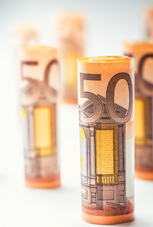 Several hundred euro banknotes stacked by value.Rolls Euro banknotes.Euro currency money. Banknotes stacked on each other in different positions Stock Photo