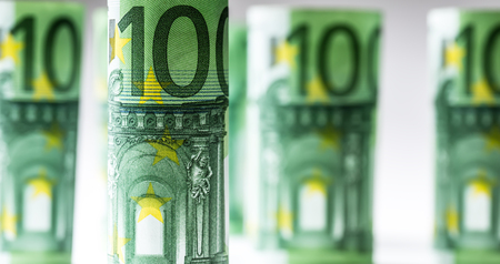 Several hundred euro banknotes stacked by value.Rolls Euro banknotes.Euro currency money. Banknotes stacked on each other in different positions Banque d'images