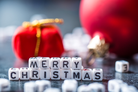 Christmas. Christmas Time. Christmas decoration.The words Merry Christmas with red christmas decorations. Stock Photo