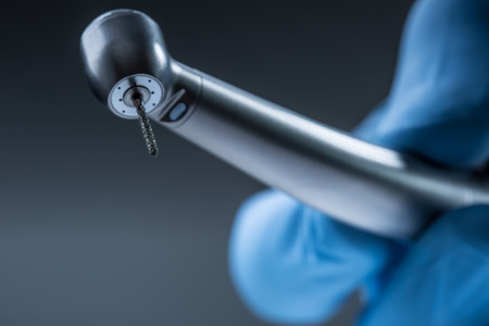 scaler: Dental instruments. Denta high speedl turbine. Dental diamond cylinder bur with hand-piece.