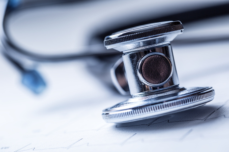 Stethoscope on a heart monitor printout.Electrocardiogram chart and stethoscope. Stock Photo
