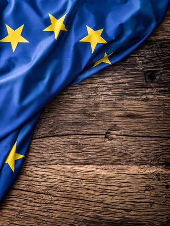 european economic community: Flag of Europe union on old wooden background. EU flag old oak background.