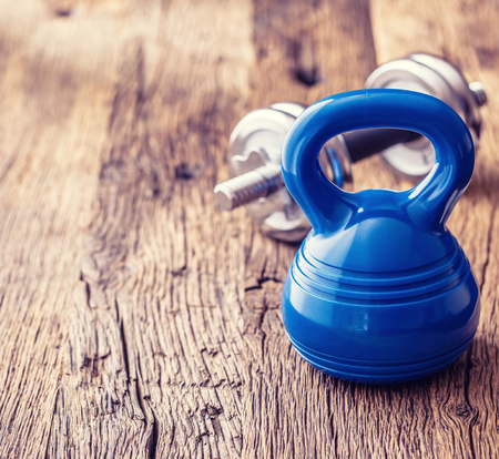 Fitness Equipment. Kettlebell  dumbbells towel water and measuring tape.