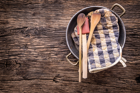 Top of view on Vintage kitchen utensils on rustic wood background.