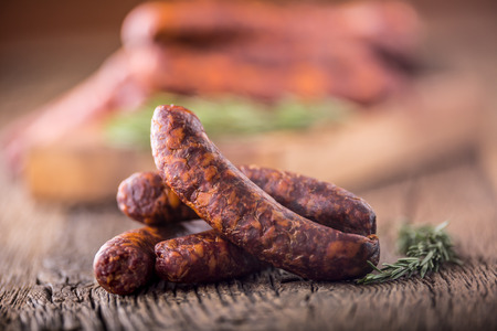 Sausages. Smoked Sausages. Chorizo sausages with vegetable rosemary spices and kitchen utensil.