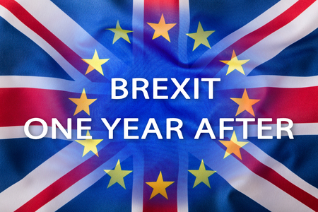 Brexit. Flags of the United Kingdom and the European Union with text one year after. Stock Photo