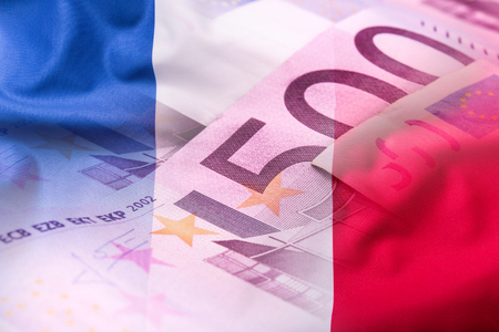 Flags of the France and euro banknotes.
