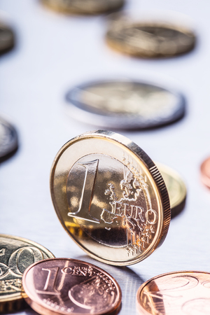 cent: One euro coin on the edge. Euro money currency. Euro coins stacked on each other in different positions. Stock Photo