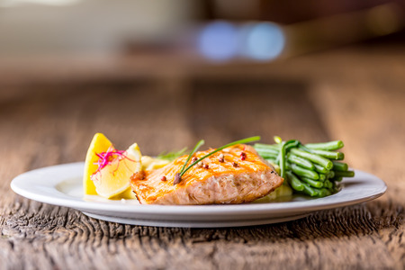 grill: Grilled Salmon. Salmon fillet with lemon and green beans. Grilled fish.