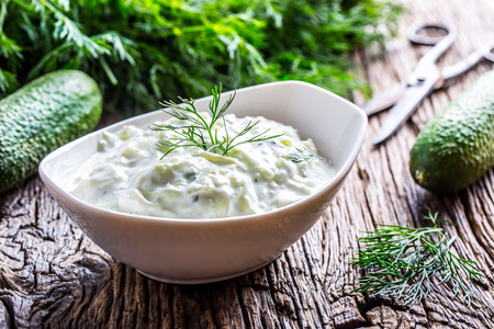 Tzatziki. Traditional greek dip sauce or dressing tzatziki prepared  with grated cucumber sour cream yogurt olive oil and fresh dill. Mediterranean cuisine. Banco de Imagens