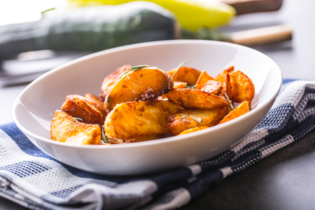 Potato. Roasted potatoes. American potatoes with salt rosemary and cumin. Roasted potato wedges delicious crispy.