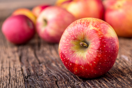 background: Apple. Red Apples in other positions on wooden board.