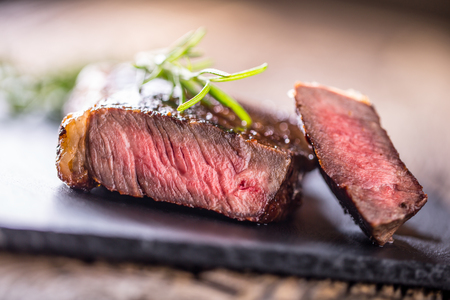 Grill juicy beef steak with salt pepper and rosemary. Stock Photo