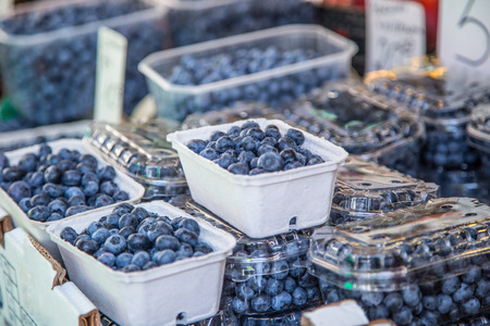 pike place: Blueberries on a farm market in the city. Fruits and vegetables at a farmers market.