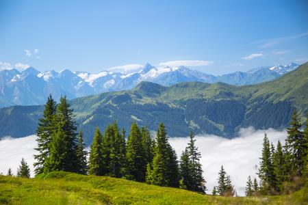 saalfelden: Austrian alps salzburg leogang. Blue sky morning fog beautiful scenery austrian alps in summer.