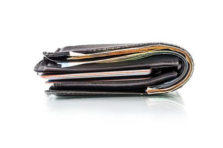 billfold: Wallet full of banknotes and credit cards isolated on white with mirror reflection. Stock Photo