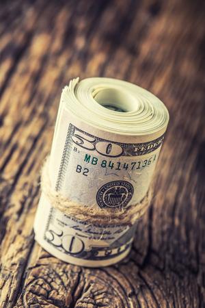 ドル紙幣のクローズ アップをロールバックされます。米ドルのスタックの現金お金アメリカ Dollars.Close を表示。 写真素材