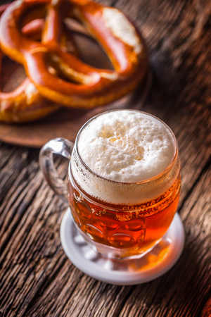 Beer and Oktoberfest. Draft beer pretzel and blue checkered tablecloth as traditional products for bavarian festival oktoberfest.