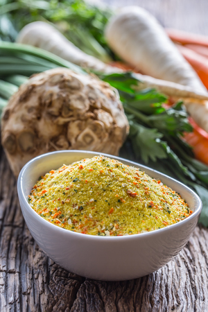 Vegeta seasoning spices condiment with dehydrated carrot parsley celery parsnips and salt with or without glutamate. Stock Photo