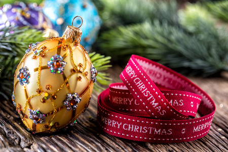 Christmas Time. Luxury golden purple blue christmas ball and decoration.Red ribbon with text happy christmas.