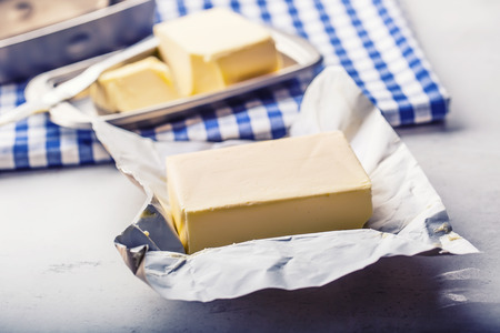 Butter. fresh butter on the kitchen table. Stock Photo