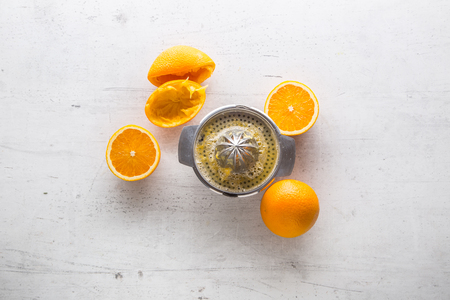 Top of view Orange and juicer on white concrete background. Stock Photo