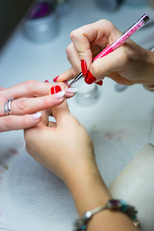 Nail Care and manicure. Nail care and the techniques of gel nail application. Stockfoto